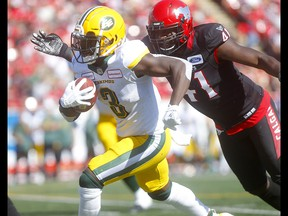 Calgary Stampeders, Cordarro Law stops Edmonton Eskimos, Natey Adjei in first half action in the Labour Day classic at McMahon stadium in Calgary on Monday, September 2, 2019. Darren Makowichuk/Postmedia