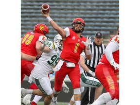 Dino's Quarterback Josiah Joseph makes a pass during the first half of action as the U of C Dino's played host to the U of A Golden Bears at McMahon Stadium on Saturday, October 5, 2019. Brendan Miller/Postmedia