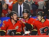 Calgary Flames Johnny Gaudreau celebrates with the purple Gatorade with teammates Sean Monahan and Elias Lindholm after scoring a power play against the San Jose Sharks in NHL hockey at the Scotiabank Saddledome in Calgary on Monday, December 31, 2018. Al Charest/Postmedia