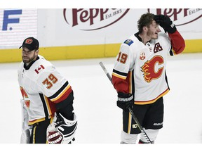 Calgary Flames winger Matthew Tkachuk (19) stands on the ice after being congratulated by goaltender Cam Talbot (39) after scoring in overtime of the team's NHL hockey game against the Nashville Predators on Thursday night in Nashville. The Flames won 6-5.