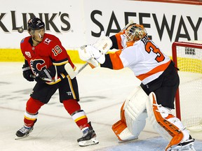 Calgary Flames Matthew Tkachuk battles Philadelphia Flyers Brian Elliott in second period action at the Scotiabank Saddledome in Calgary on Tuesday, Oct. 15, 2019.
