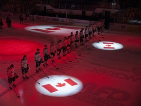 The AJHL Calgary Mustangs line up for the national anthem before facing the Fort McMurray Oil Barons on Jan. 13, 2017.