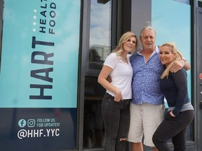 Outside Heart Healthy Foods in Calgary's East Village with Beans Hart and her dad, Bret Hart.
