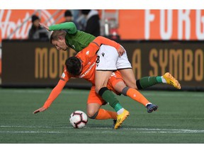 Oct 26, 2019; Hamilton, Ontario, CAN;  Cavalry FC midfielder Julian Buscher (8) battles for the ball with Forge FC midfielder Tristan Borges (19) in the first half of a Canadian Premier League soccer final match at Tim Hortons Field. Mandatory Credit: Dan Hamilton-USA TODAY Sports for CPL ORG XMIT: USATSI-415705