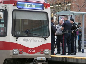 Calgary Police and Transit officers seen at the scene of an alleged assault on a CTrain in downtown Calgary on Friday, November 15, 2019. One male was taken to hospital.