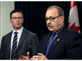 Alberta Justice Minister Doug Schweitzer, left, with Alberta Transportation Minister Ric McIver, said on Tuesday, Nov. 26, 2019.