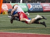 CP-Web.  University of Calgary Dinos' Grant McDonald, top, tackles University of Montreal Carabins' Ryth-Jean Giraud during first half U Sports Vanier Cup university football action in Quebec City, Saturday, Nov. 23, 2019. THE CANADIAN PRESS/Jacques Boissinot ORG XMIT: JQB101