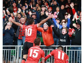 Cavalry FC Sergio Camargo celebrates with fans after a second half goal during CPL soccer action between FC Edmonton and Cavalry FC at ATCO Field at Spruce Meadows in Calgary on Saturday, October 19, 2019. Cavalry won 3-1 and took the fall season. Jim Wells/Postmedia