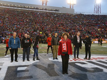 Alberta Lieutenant Governor Lois Mitchell takes part the coin toss before the 107th Grey Cup CFL Championship football game in Calgary at McMahon Stadium, Sunday, November 24, 2019. Jim Wells/Postmedia
