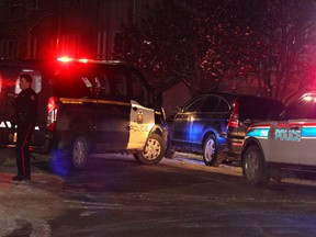 Calgary police investigate a possible shooting in the 1100 block of 14th Avenue S.W. Friday, Nov. 29, 2019.