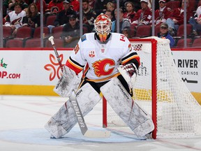 Goaltender Cam Talbot #39 of the Calgary Flames in action during the first period of the NHL game against the Arizona Coyotes at Gila River Arena on December 10, 2019 in Glendale, Arizona.