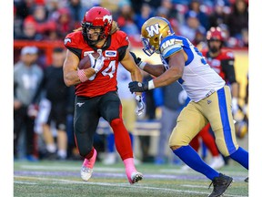 Calgary Stampeders Ante Milanovic-Litre is tackled by Jackson Jeffcoat Winnipeg Blue Bombers during CFL football in Calgary on Saturday, October 19, 2019. Al Charest/Postmedia