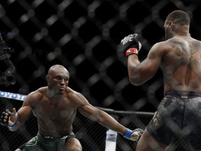Tyron Woodley and Kamaru Usman, of Nigeria, fight during their welterweight title bout during UFC 235 at T-Mobile Arena on March 02, 2019 in Las Vegas, Nevada.