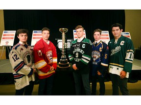 Calgary AAA players (L-R)  Heath Armstrong (Buffaloes), Kayden Smith (Flames), Sam Simard (Okotoks Oilers), Rhys Betham (Royals) and Clarke Huxley (Northstars) pose with the trophy at a press conference to kick off the Macs International Hockey Tournament in Calgary on Wednesday, December 11, 2019. Jim Wells/Postmedia