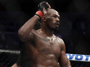Jon Jones celebrates after defeating Anthony Smith following their light heavyweight title bout during UFC 235 at T-Mobile Arena in Las Vegas on March 2, 2019.