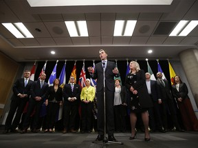 Bill Morneau, Canada's finance minister, center, speaks while Mona Fortier, Canada's associate finance minister and middle class prosperity minister, center right, listens during a news conference with provincial and territorial finance ministers in Ottawa, Ontario, Canada, on Tuesday, Dec. 17, 2019. Photographer: David Kawai/Bloomberg ORG XMIT: 775453454