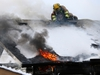 Calgary firefighters attack a fire from the roof of a home on Templeby Drive N.E. on Sunday January 19, 2020.