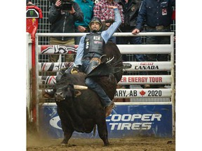 Garrett Green (Meeting Creek, Alta.) paired up with TNT (Vold Rodeo) in the second round of the PBR Canada's Monster Energy Tour event at Calgary's Nutrien Western Event Centre at Stampede Park on Saturday. Photo by Sean Libin/Special for Postmedia.
