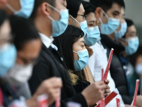 Local medical workers hold a strike near Queen Mary Hospital as they demand the city close its border with China to reduce the coronavirus spreading, in Hong Kong on February 3, 2020.