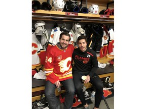 Jesse Hamonic, left, and his brother Travis smile for a photo during the Calgary FlamesÕ annual Fathers/Mentors Trip in 2019. Travis is a defenceman for the Flames, and Jesse among his biggest supporters. Courtesy photo.