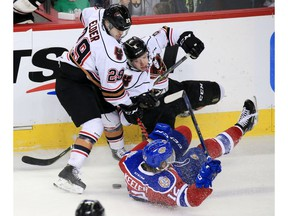 The Calgary Hitmen's Kaden Elder and Luke Prokop collide with the Edmonton Oil Kings' Liam Keeler during WHL action at the Scotiabank Saddledome in Calgary on Sunday March 17, 2019.  Gavin Young/Postmedia