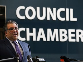 Calgary Mayor Naheed Nenshi speaks to media outside council chambers on Monday, April 6, 2020. The rest of council took part in council from home amidst COVID-19 precautions. Gavin Young/Postmedia