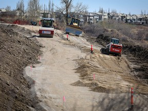 Crews continue to work on the Douglasdale and McKenzie Lake slope stability / pathway project on Tuesday May 5, 2020 a city report today said it will cost taxpayers $28 million.