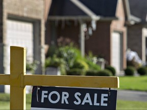 """A """"for sale"""" sign is posted outside a home in this file photo."""