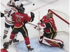 The Calgary Flames' Mark Giordano and Edmonton Oilers' Zack Kassian battle for the rebound as Flames goalie David Rittich makes the save during an NHL exhibition game at Rogers Place in Edmonton on Tuesday, July 28, 2020.