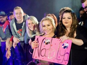 Natalya Neidhart interacting with fans during a WWE live event.