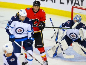 Calgary Flames Milan Lucic battles against Nathan Beaulieu of the Winnipeg Jets during pre-season NHL hockey in Calgary on Tuesday September 24, 2019. Al Charest / Postmedia