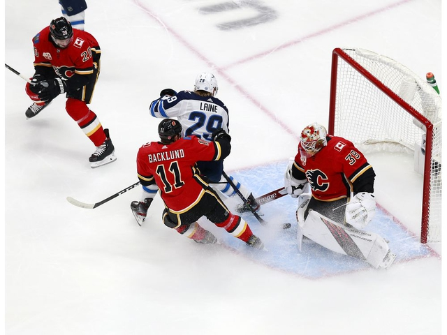 EDMONTON, ALBERTA - AUGUST 01: Cam Talbot #39 of the Calgary Flames and Mikael Backlund #11 of the Calgary Flames defend the net against Patrik Laine #29 of the Winnipeg Jets in Game One of the Western Conference Qualification Round prior to the 2020 NHL Stanley Cup Playoffs at Rogers Place on August 01, 2020 in Edmonton, Alberta. (Photo by Jeff Vinnick/Getty Images) (Photo by Jeff Vinnick/Getty Images)
