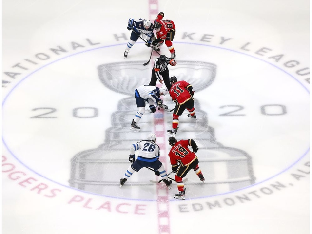 EDMONTON, ALBERTA - AUGUST 03:  The Winnipeg Jets and the Calgary Flames face off to start Game Two of the Western Conference Qualification Round prior to the 2020 NHL Stanley Cup Playoffs at Rogers Place on August 03, 2020 in Edmonton, Alberta. (Photo by Jeff Vinnick/Getty Images)