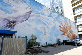 Doug Driediger's mural Giving Wings to the Dream on the old CUPS building on 7th Avenue on Tuesday, Aug. 11, 2020.