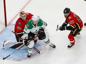 Calgary Flames forward Sam Bennett and goaltender Cam Talbot defend against Dallas Stars forward Corey Perry during Game 6 of their first-round series at Rogers Place in Edmonton on Aug. 20, 2020. Perry Nelson/USA TODAY