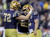 PHILADELPHIA, PENNSYLVANIA - DECEMBER 14:  Malcolm Perry #10 of the Navy Midshipmen celebrates his touchdown with teammate Ford Higgins #72 in the fourth quarter against the Army Black Knights at Lincoln Financial Field on December 14, 2019 in Philadelphia, Pennsylvania.The Navy Midshipmen defeated the Army Black Knights 31-7. (Photo by Elsa/Getty Images)