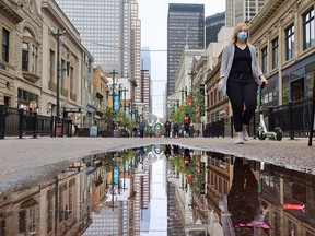 Calgarians walk in downtown Calgary on a cool day, Monday, Sept. 14, 2020.