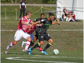 Canadian Premier League - York9 FC  vs Cavalry FC - Charlottetown, PEI- Sept 5, 2020]. Cavalry FC #15 Elliot Simmons chases down the ball.
