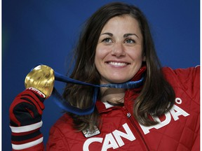 OLY--Vancouver 2010 Winter Olympics;  Canada's Maelle Ricker of holds her gold medal for snowboard cross during medal ceremonies at BC Place in Vancouver, B.C., on Wednesday, Feb. 17, 2010. Photo by ANDRE FORGET/QMI AGENCY