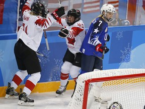 Canada forward Haley Irwin, left, celebrates her goal against the United States with teammate Blayre Turnbull during their game at the 2018 Olympic Winter Games in Pyeongchang, South Korea, on Feb. 21, 2018.