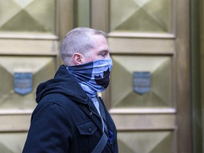 Const. Alexander Dunn, the police officer charged with assault for slamming Dalia Kafi to the floor, walks out of Calgary Courts Centre on Wednesday, October 28, 2020.