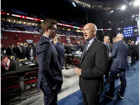 VANCOUVER, BRITISH COLUMBIA - JUNE 22: (L-R) Kyle Dubas of the Toronto Maple Leafs  and Jarmo Kekalainen of the Columbus Blue Jackets attend the 2019 NHL Draft at Rogers Arena on June 22, 2019 in Vancouver, Canada.