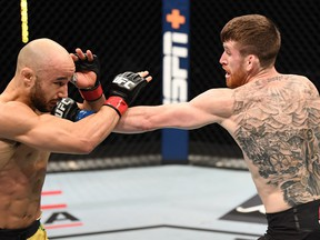 In this handout image provided by UFC, Cory Sandhagen punches Marlon Moraes of Brazil in their bantamweight bout during the UFC Fight Night event inside Flash Forum on UFC Fight Island on Saturday night in Yas Island, Abu Dhabi, United Arab Emirates. Photo by Josh Hedges/Zuffa LLC via Getty Images