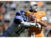 Oct 17, 2020; Knoxville, TN, USA; Tennessee quarterback Jarrett Guarantano (2) is sacked by Kentucky linebacker Jordan Wright (15)  during a game between Tennessee and Kentucky at Neyland Stadium in Knoxville, Tenn. on Saturday, Oct. 17, 2020. Mandatory Credit: Calvin Mattheis-USA TODAY NETWORK ORG XMIT: IMAGN-427654