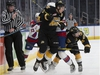 The Edmonton Oil Kings' Jake Neighbours (21) is checked by the Brandon Wheat Kings' Braden Schneider (2) and Connor Gutenberg (24) during third period WHL action at Rogers Place, in Edmonton Tuesday Jan. 28, 2020. The Oil Kings' won 6-2. Photo by David Bloom