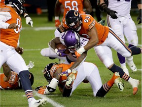 CHICAGO, ILLINOIS - NOVEMBER 16:  Dalvin Cook #33 of the Minnesota Vikings tackled by James Vaughters #93 of the Chicago Bears at Soldier Field on November 16, 2020 in Chicago, Illinois.