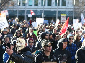 Hundreds of upporters gather during a large rally in Municipal Plaza in downtown Calgary on Saturday, November 28, 2020. About 1000 participants, from a few different groups were opposed to a number of things-the federal, provincial and civic governments, anti-masking, and end the lockdown. The group eventually marched up and down Stephen Ave Mall.