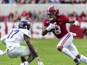 Alabama wide receiver John Metchie (8) runs a pass reception against Western Carolina defensive back Reggie Jones (17) during the first half of an NCAA college football game, Saturday, Nov. 23, 2019, in Tuscaloosa, Ala.
