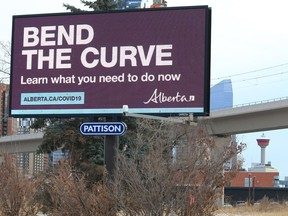 An electronic billboard displays Alberta COVID-19 information for drivers heading into downtown Calgary on Thursday, December 17, 2020.