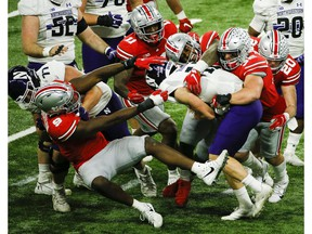 Dec 19, 2020; Indianapolis, IN, USA; Ohio State Buckeyes linebacker Tuf Borland (32) and Ohio State Buckeyes defensive tackle Taron Vincent (6) sack Northwestern Wildcats quarterback Peyton Ramsey (12) during the third quarter of the Big Ten Championship football game between the Ohio State Buckeyes and the Northwestern Wildcats on Saturday, Dec. 19, 2020 at Lucas Oil Stadium in Indianapolis. Mandatory Credit: Joshua A. Bickel-USA TODAY NETWORK ORG XMIT: IMAGN-444233